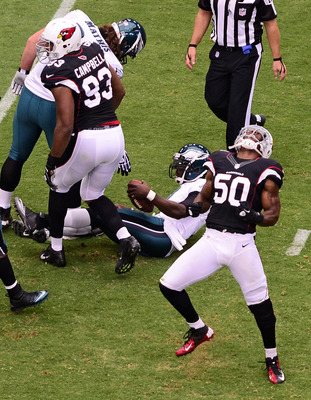 O'Brien Schofield celebrates a sack of Michael Vick.