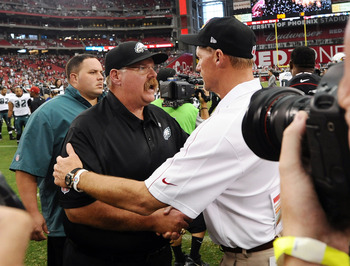 Whisenhunt (right) shakes Andy Reid's hand after the win.