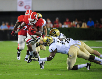 ATHENS, GA - SEPTEMBER 22: Todd Gurley #3 of the Georgia Bulldogs carries the ball against Kenny Ladler #1 of the Vanderbilt Commodores at Sanford Stadium on September 22, 2012 in Athens, Georgia. (Photo by Scott Cunningham/Getty Images)