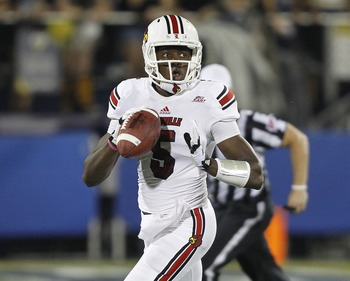 MIAMI, FL - SEPTEMBER 22: Teddy Bridgewater #5 of the Louisville Cardinals runs out of the pocket with the ball against the Florida International Golden Panthers on September 22, 2012 at FIU Stadium in Miami, Florida. The Cardinals defeated the Panthers 2