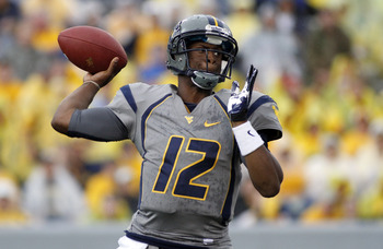 MORGANTOWN, WV - SEPTEMBER 22:  Geno Smith #12 of the West Virginia Mountaineers drops back to pass against the Maryland Terrapins during the game on September 22, 2012 at Mountaineer Field in Morgantown, West Virginia.  WVU defeated Maryland 31-21.  (Pho