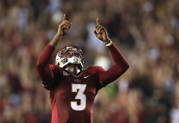 TALLAHASSEE, FL - SEPTEMBER 22:  EJ Manuel #3 of the Florida State Seminoles celebrates after his teammate runs for a touchdown during their game against the Clemson Tigers at Doak Campbell Stadium on September 22, 2012 in Tallahassee, Florida.  (Photo by