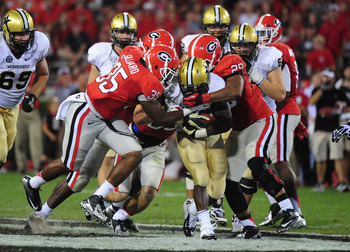 ATHENS, GA - SEPTEMBER 22: Zac Stacy #2 of the Vanderbilt Commodores is tackled by Michael Gilliard #35 and Jarvis Jones #29 of the Georgia Bulldogs at Sanford Stadium on September 22, 2012 in Athens, Georgia. (Photo by Scott Cunningham/Getty Images)