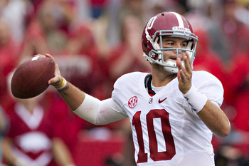 FAYETTEVILLE, AR - SEPTEMBER 15:   AJ McCarron #10 of the Alabama Crimson Tide throws a pass during a game against the Arkansas Razorbacks at Razorback Stadium on September 15, 2012 in Fayetteville, Arkansas.  (Photo by Wesley Hitt/Getty Images)