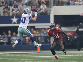 Sep 23, 2012; Arlington, TX, USA; Dallas Cowboys linebacker Sean Lee (50) intercepts the ball in front of Tampa Bay Buccaneers running back D.J. Ware (28) in the first quarter at Cowboys Stadium. Mandatory Credit: Matthew Emmons-US PRESSWIRE