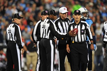 Nov 6, 2011; Nashville, TN, USA; NFL referees gather to discuss a call between plays in a game between the Tennessee Titans and the Cincinnati Bengals during the second half at LP Field. The Bengals beat the Titans 24-17. Mandatory Credit: Don McPeak-US P