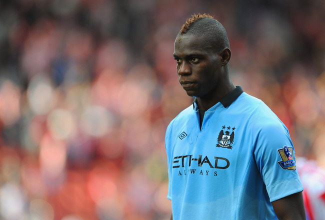 STOKE ON TRENT, ENGLAND - SEPTEMBER 15: Mario Balotelli of Manchester City looks on during the Barclays Premier League match between Stoke City and Manchester City at the Britannia Stadium on September 15, 2012 in Stoke on Trent, England.  (Photo by Micha