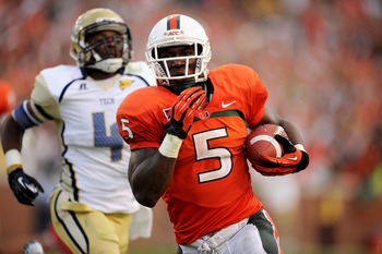 Sep 22, 2012; Atlanta, GA, USA; Miami Hurricanes running back Mike James (5) scores the winning touchdown in overtime against the Georgia Tech Yellow Jackets at Bobby Dodd Stadium. Miami won 42-36. Mandatory Credit: Kevin Liles-US PRESSWIRE