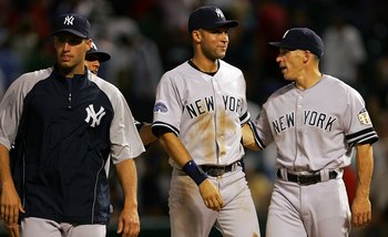 Yankees' players Derek Jeter and Andy Pettitte walk with manager Joe Girardi.