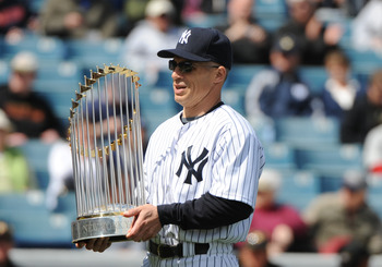 Yankees manager Joe Girardi hoists his 2009 World Series Trophy.
