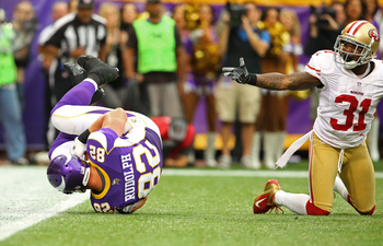 Rudolph's two scores led the Vikings to a stunning upset of the 49ers.
