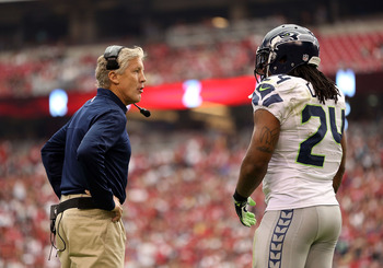 GLENDALE, AZ - SEPTEMBER 09:  Head coach Pete Carroll of the Seattle Seahawks talks with running back Marshawn Lynch #24 during the season opener against the Arizona Cardinals at the University of Phoenix Stadium on September 9, 2012 in Glendale, Arizona.