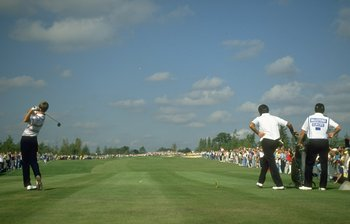 Paul Azinger tees off; Seve Ballesteros is on the move.
