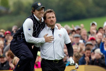 Rory McIlroy (left) gives support to Graeme McDowell.