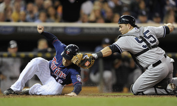 Russell Martin tries to tag Ryan Doumit in a Sept. 24 game against the Minnesota Twins