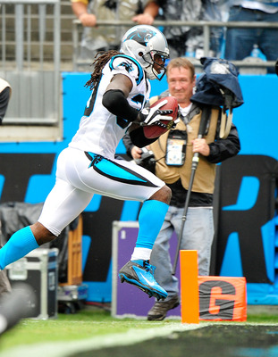 Panthers safety Charles Godfrey (30) returns an interception for a touchdown against the Saints in Week 2.