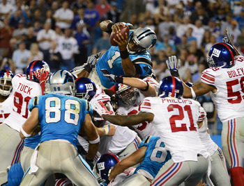 Cam Newton (1) soared over the goal line for the Panthers' lone score against the Giants in Week 3.