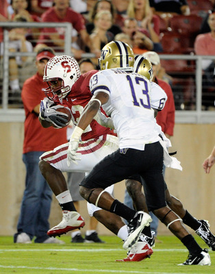 STANFORD, CA - OCTOBER 22: Anthony Wilkerson #32 of Stanford Cardinal scores on an 18 yard touchdown run dragging Desmond Trufant #18 and Will Shamburger #13 of Washington Huskies into the endzone at Stanford Stadium on October 22, 2011 in Stanford, Calif