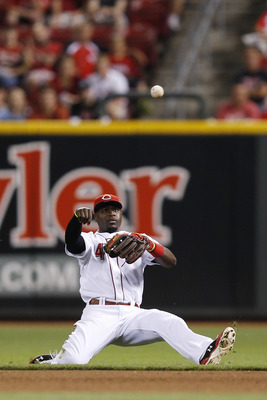 CINCINNATI, OH - SEPTEMBER 12: Brandon Phillips #4 of the Cincinnati Reds throws to first after fielding the ball against the Pittsburgh Pirates during the game at Great American Ball Park on September 12, 2012 in Cincinnati, Ohio. The Reds won 2-1. (Phot