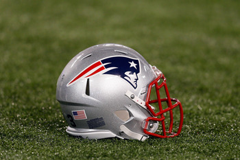 BALTIMORE, MD - SEPTEMBER 23: A New England Patriots helmet sits on the turf before the start of the Patriots game against the Baltimore Ravens at M&T Bank Stadium on September 23, 2012 in Baltimore, Maryland.  (Photo by Rob Carr/Getty Images)