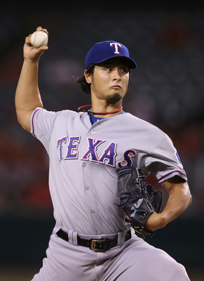 ANAHEIM, CA - SEPTEMBER 20:  Yu Darvish #11 of the Texas Rangers pitches against the Los Angeles Angels of Anaheim in the first inning at Angel Stadium of Anaheim on September 20, 2012 in Anaheim, California.  (Photo by Jeff Gross/Getty Images)