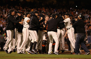 The San Francisco Giants celebrate after clinching the NL West title.