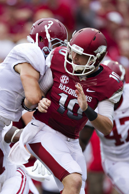 FAYETTEVILLE, AR - SEPTEMBER 15:    Brandon Allen #10 of the Arkansas Razorbacks is hit after throwing a pass by Vinnie Sunseri #3 of the Alabama Crimson Tide at Razorback Stadium on September 15, 2012 in Fayetteville, Arkansas.  The Crimson Tide defeated