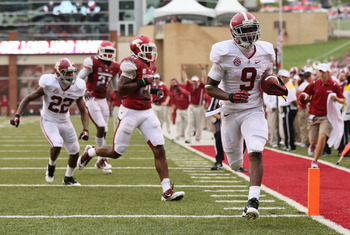 Sep 15, 2012; Fayetteville, AR, USA; Alabama Crimson Tide wide receiver Amari Cooper (9) runs after a catch for a touchdown against the Arkansas Razorbacks during the second quarter at Donald W. Reynolds Razorback Stadium. Mandatory Credit: Nelson Chenaul