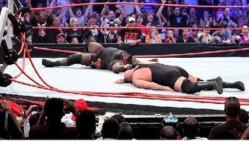 Big Show and Mark Henry in a no-contest last year after the ring collapsed. (Photo courtesy of tribalwrestling.com)