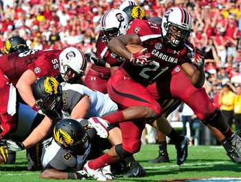 COLUMBIA, SC - SEPTEMBER 22:  Marcus Lattimore #21 of the South Carolina Gamecocks breaks into the end zone for a touchdown against the Missouri Tigers during play at Williams-Brice Stadium on September 22, 2012 in Columbia, South Carolina.  (Photo by Gra