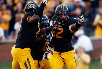 COLUMBIA, MO - SEPTEMBER 15:  Defensive lineman Michael Sam #52 of the Missouri Tigers is congratulated by teammates after sacking quarterback Taylor Kelly #10 of the Arizona State Sun Devils during the game at Faurot Field/Memorial Stadium on September 1