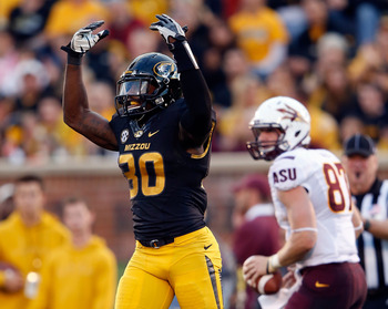 COLUMBIA, MO - SEPTEMBER 15:  Safety Kenronte Walker #30 of the Missouri Tigers celebrates after stopping tight end Chris Coyle #87 of the Arizona State Sun Devils during the game at Faurot Field/Memorial Stadium on September 15, 2012 in Columbia, Missour