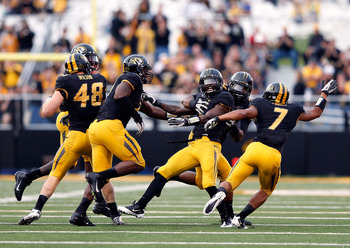 COLUMBIA, MO - SEPTEMBER 15:  Defensive back Kip Edwards #1 of the Missouri Tigers is congratulated by teammates after intercepting a pass during the game against the Arizona State Sun Devils at Faurot Field/Memorial Stadium on September 15, 2012 in Colum