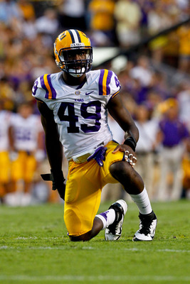 September 8, 2012; Baton Rouge, LA, USA;  LSU Tigers defensive end Barkevious Mingo (49) against the Washington Huskies during a game at Tiger Stadium. LSU defeated Washington 41-3.  Mandatory Credit: Derick E. Hingle-US PRESSWIRE