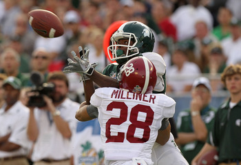 ORLANDO, FL - JANUARY 01:  Keshawn Martin #82 of the Michigan State Spartans has a pass broken up by DeMarcus Milliner #28 of the Alabama Crimson Tide during the Capitol One Bowl at the Florida Citrus Bowl on January 1, 2011 in Orlando, Florida.  (Photo b