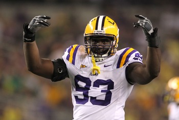 Sep 3, 2011; Arlington, TX, USA; LSU Tigers defensive tackle Bennie Logan (93) celebrates with the crowd against the Oregon Ducks at Cowboys Stadium. Mandatory Credit: Matthew Emmons-US PRESSWIRE