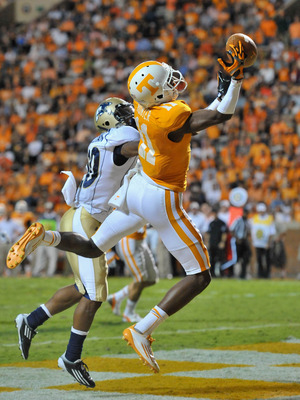Sep 22, 2012; Knoxville, TN, USA; Tennessee Volunteers wide receiver Justin Hunter (11) leaps for a pass in the end zone against Akron Zips cornerback Malachi Freeman (20) during the first half at Neyland Stadium. Mandatory Credit: Jim Brown-US PRESSWIRE