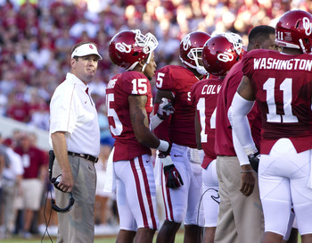 Sept 8, 2012; Norman OK, USA; Oklahoma Sooners head coach Bob Stoops looks at the clock during the first quarter at Gaylord Family - Oklahoma Memorial Stadium.  Mandatory Credit: Richard Rowe-US PRESSWIRE