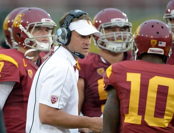 Sep 22, 2012; Anaheim, CA, USA; Southern California Trojans coach Lane Kiffin (center), quarterback Matt Barkley (left), center Abe Markowitz (50) and receiver De'Von Flournoy (10) react during the game against the California Golden Bears at the Los Angel