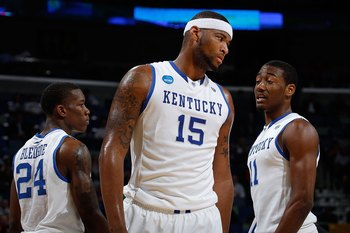 Eric Bledsoe (24), DeMarcus Cousins (15) and John Wall (11)