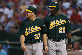 Brandon Moss and Chris Carter are vying for time in the lineup