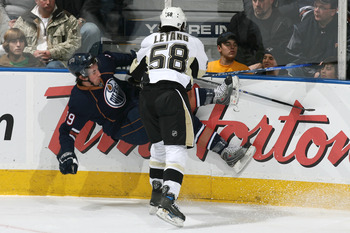 Kris Letang lands a huge hit during a 2007 game against the Edmonton Oilers.