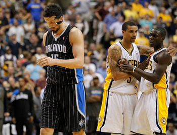 INDIANAPOLIS, IN - MAY 08: Hedo Turkoglu #15 of the Orlando Magic walks up court while Darren Collison #2 and George Hill #3 of the Indiana Pacers celebrate behind him in Game Five of the Eastern Conference Quarterfinals during the 2012 NBA Playoffs on Ma