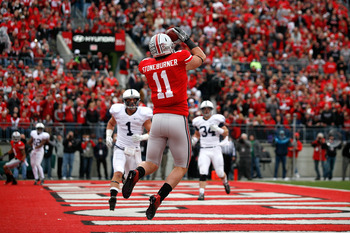 Jake Stoneburner catches a touchdown pass against Penn State University on Nov. 11, 2011