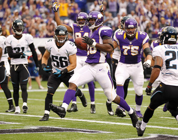 MINNEAPOLIS, MN - SEPTEMBER 9: Adrian Peterson #28 of the Minnesota Vikings scores a touchdown in the second quarter against the Jacksonville Jaguars during NFL opening day September 9, 2012 at Mall of America Field at the Hubert H. Humphrey Metrodome in
