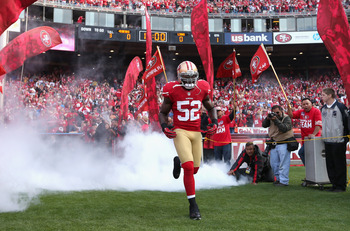 SAN FRANCISCO, CA - SEPTEMBER 16:  Patrick Willis #52 of the San Francisco 49ers runs onto the field for their game against the Detroit Lions at Candlestick Park on September 16, 2012 in San Francisco, California.  (Photo by Ezra Shaw/Getty Images)