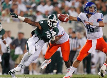 EAST LANSING, MI - AUGUST 31: William Gholston #2 of the Michigan State Spartans gets around the block of Faraji Wright #75 of the Boise State Broncos on his way to quarterback Joe Southwick #16 at Spartan Stadium on August, 2010 in East Lansing, Michigan