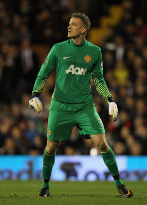LONDON, ENGLAND - DECEMBER 21:  Goalkeeper Anders Lindegaard of Manchester United looks on during the Barclays Premier League match between Fulham and Manchester United at Craven Cottage on December 21, 2011 in London, England.  (Photo by Clive Rose/Getty