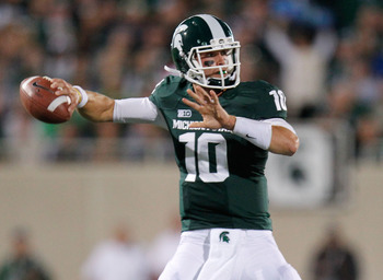 EAST LANSING, MI - SEPTEMBER 15:  Andrew Maxwell #10 of the Michigan State Spartans throws a first quarter pass while playing the Notre Dame Fighting Irish at Spartan Stadium Stadium on September 15, 2012 in East Lansing, Michigan. (Photo by Gregory Shamu