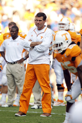 KNOXVILLE, TN - SEPTEMBER 15: Derek Dooley head coach of the Tennessee Volunteers during pregame warm-ups before their game against the  Florida Gators at Neyland Stadium on September 15, 2012 in Knoxville, Tennessee.    (Photo by John Sommers II/Getty Im